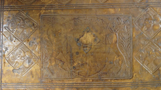 Figure 2, Auckland Libraries, Sir George Grey Special Collections, Med. MS G.132, lower cover, showing panel and stamps and indentations from medieval furnishing