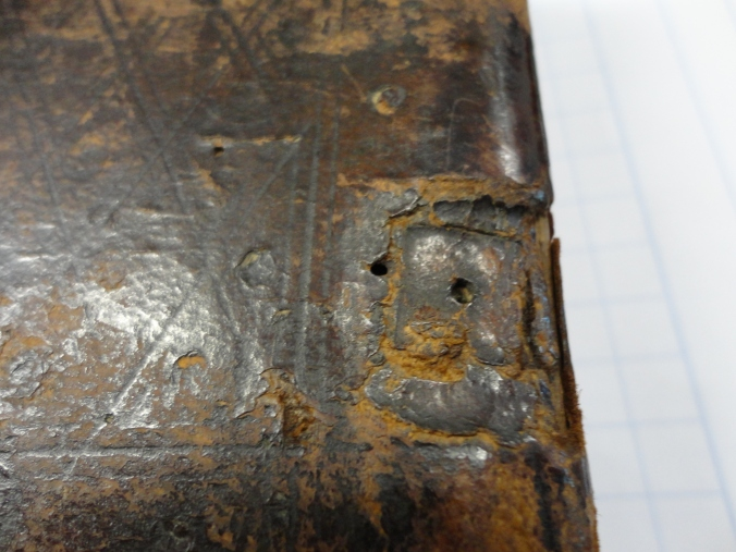 Dunedin, Hewitson Library, Hours -- indentations from clasps (detail 2)